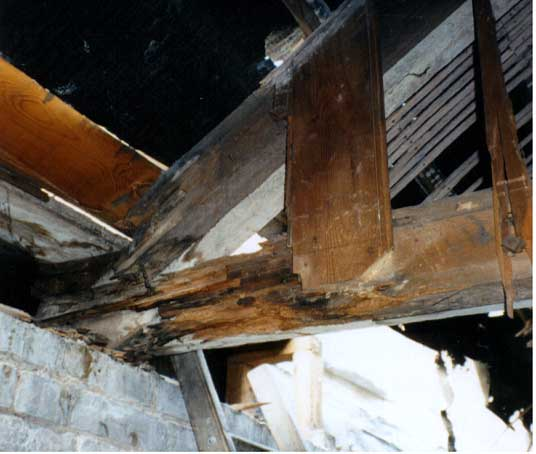 Valley gutter failure in a roof truss leading to wet rot